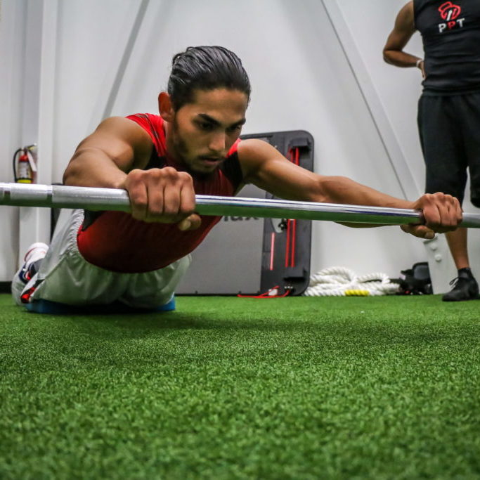 Our Programs - Adult Functional Training OR Our Principals - Anti-Core Training (Barbell Rollout)