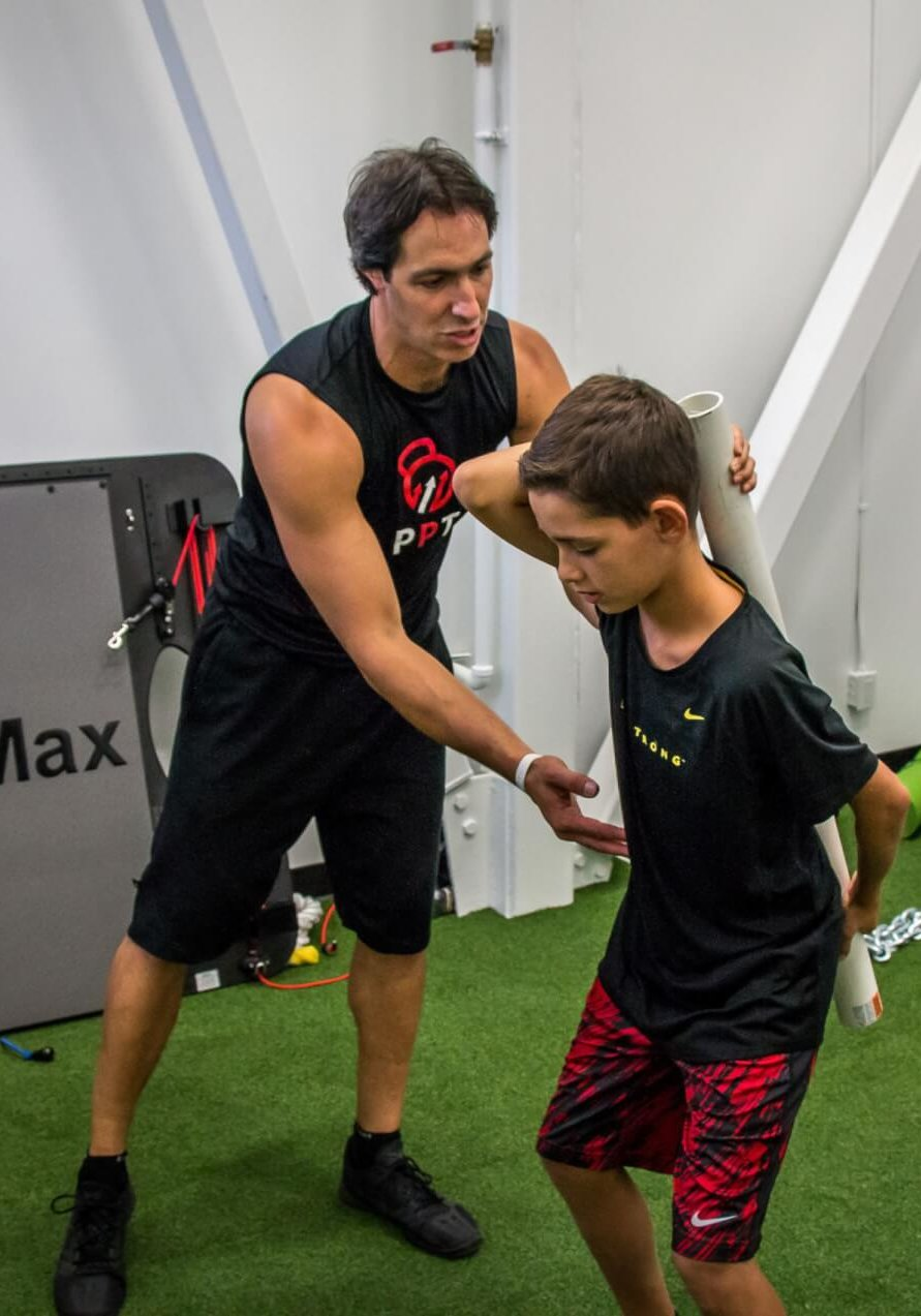 Our Programs - Youth and Teen Functional Training (Hip Hinge with Dowel)
